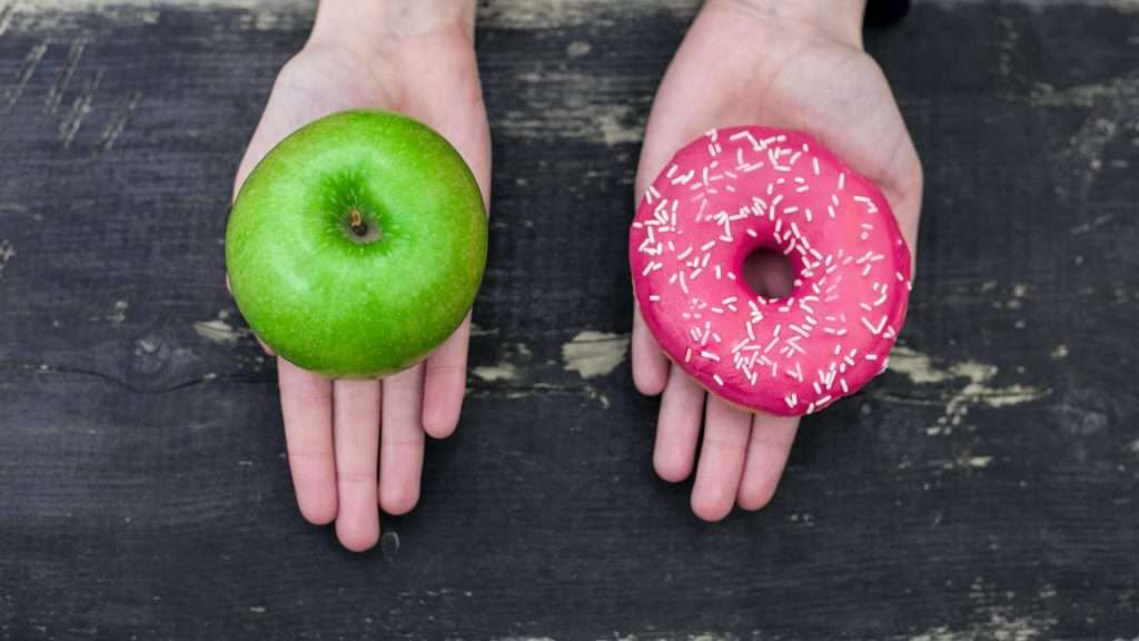 Which do you chose, the doughnut in one hand or the apple in the other hand